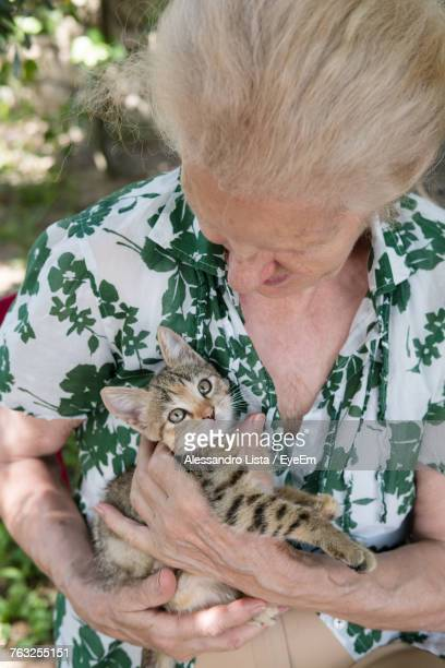 Senior Woman With Cat At Park