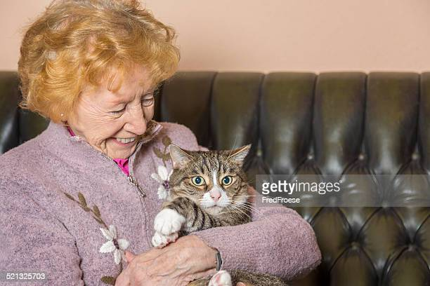 Senior woman with cat