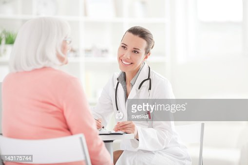 Senior woman with doctor. : Stock Photo