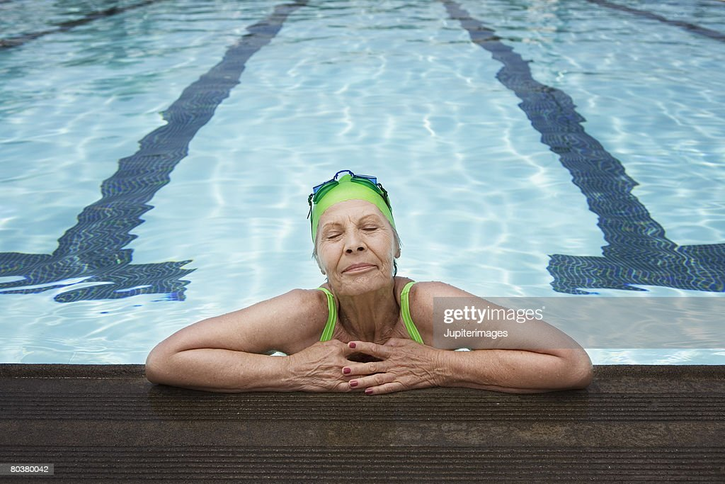 Senior Woman With Eyes Closed In Swimming Pool Stock Photo Getty Images