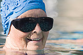 Senior woman with glaucoma glasses in a swimming pool