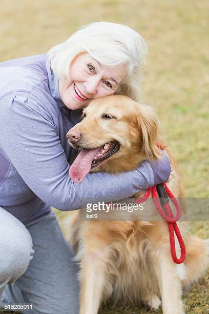 Senior woman with golden retriever