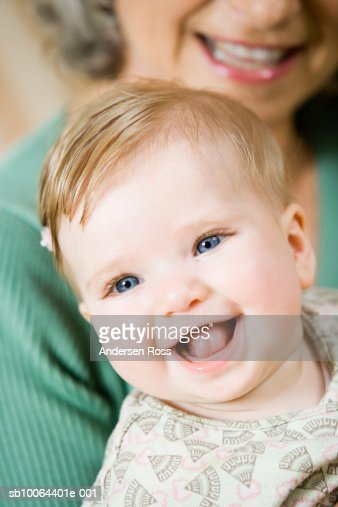 Senior woman with granddaughter (6 months), close-up on baby : Stock Photo