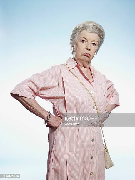 Senior woman with hands on her hips looking disgruntled