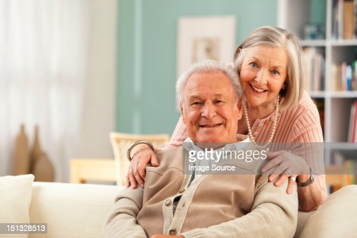 Senior woman with hands on mans shoulders : Stock Photo