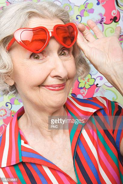 Senior woman with heart shaped sunglasses