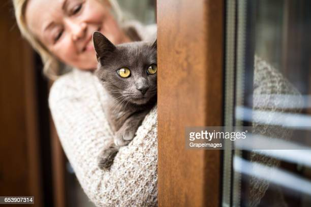 Senior woman with her cat at home relaxing