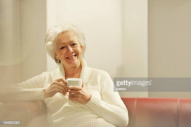 senior woman with hot drink