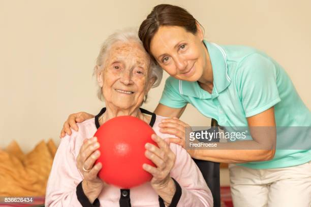 Senior woman with physical therapist