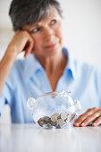 Senior Woman with Piggy Bank