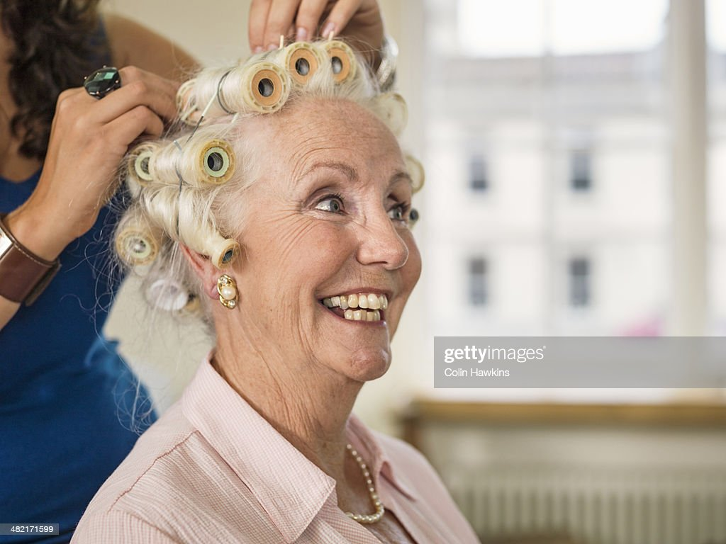 Senior woman with rollers at hairdressers