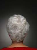 Senior woman with short grey hair, rear view, head and shoulders