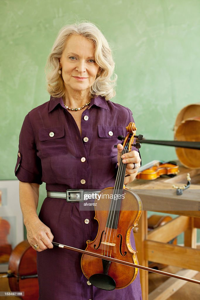 Senior woman with violin : Stock Photo