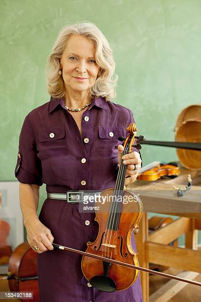 Senior woman with violin