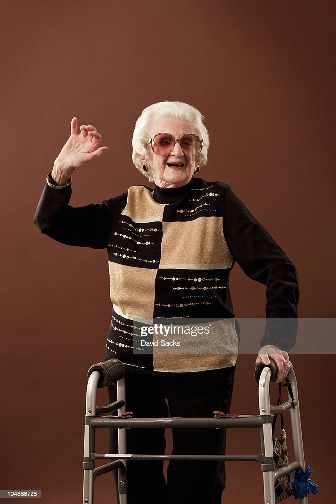 Senior woman with walker dancing : Stock Photo