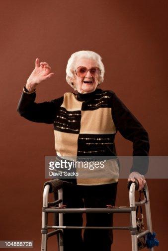 Senior woman with walker dancing : Stock Photo