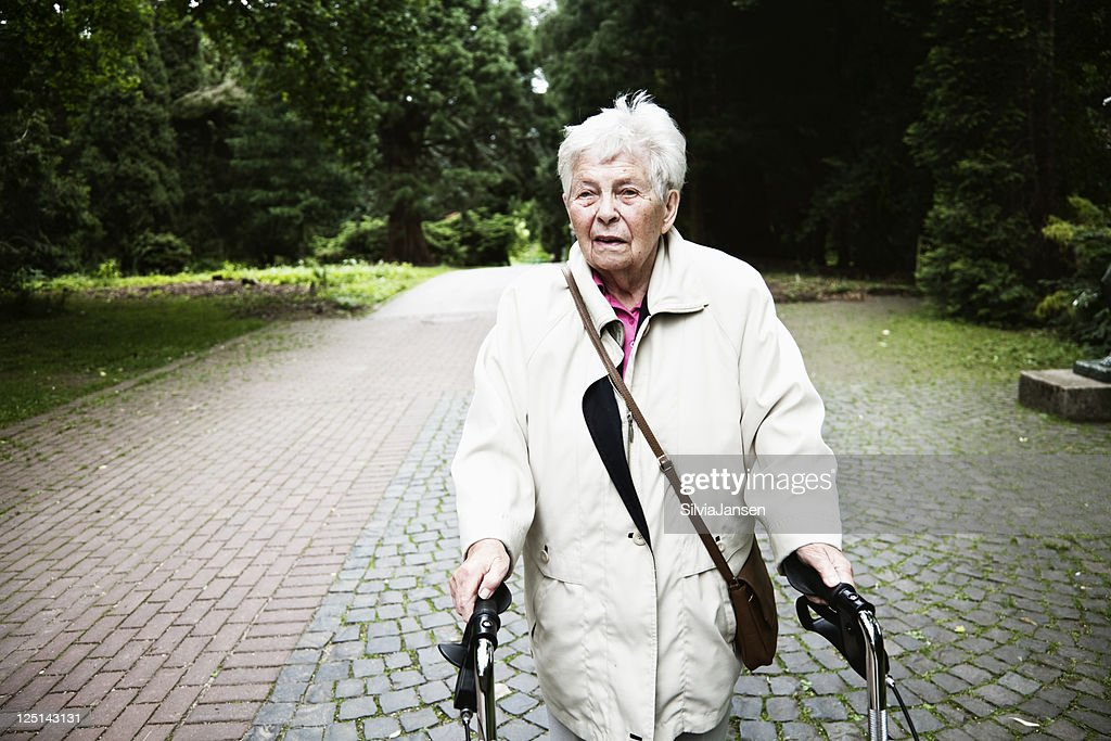 senior woman with walker in park