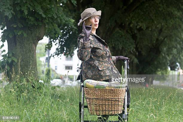 Senior woman with wheeled walker having a break