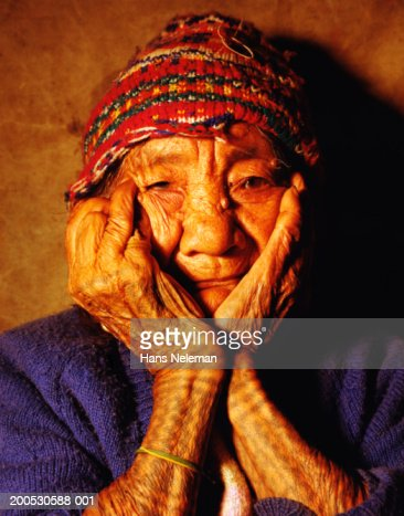 Senior woman with wizened face and hands, portrait : Stock Photo