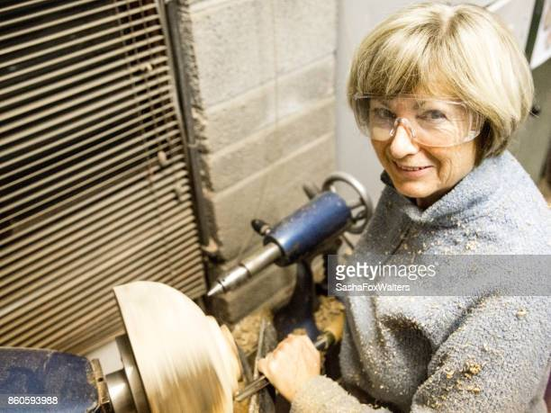 Senior woman wood turning