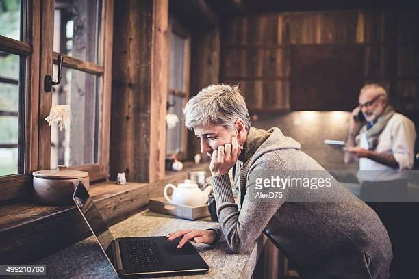 Senior woman work on laptop