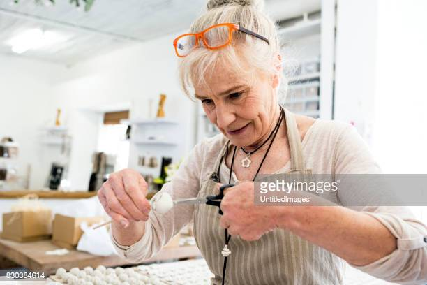 Senior woman working with clay