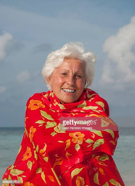 Senior woman wrapped in shawl, portrait
