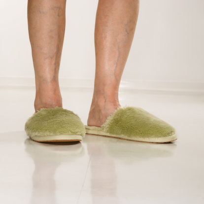Old lady feet stock photos and pictures getty images for H m bedroom slippers