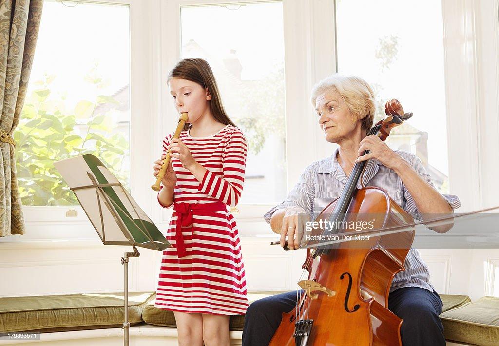 Senior women and child playing music. : Stock Photo