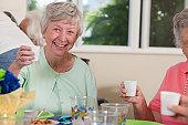 Senior women at a luncheon enjoying a drink
