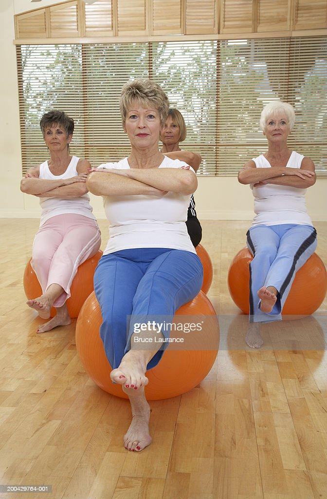 Senior women doing excercises with ball : Stock Photo