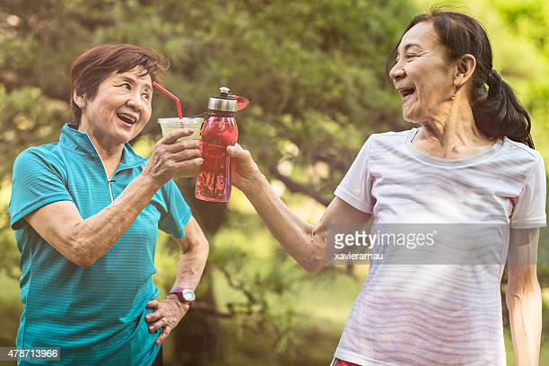 Senior women drinking after the exercises in Yoyogi park