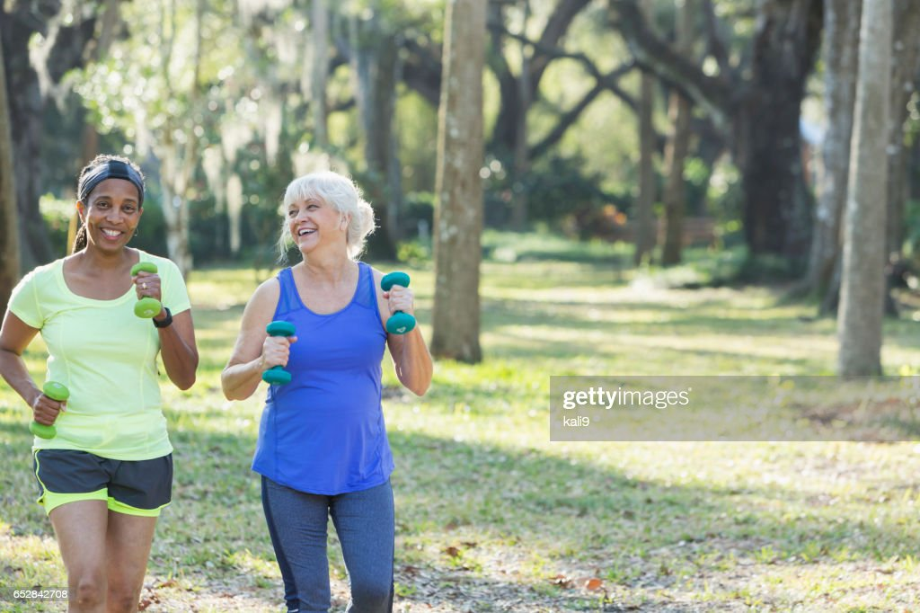 Senior women exercising in park run with hand weights : Stock Photo