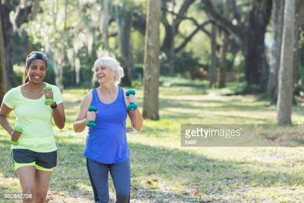 Senior women exercising in park run with hand weights