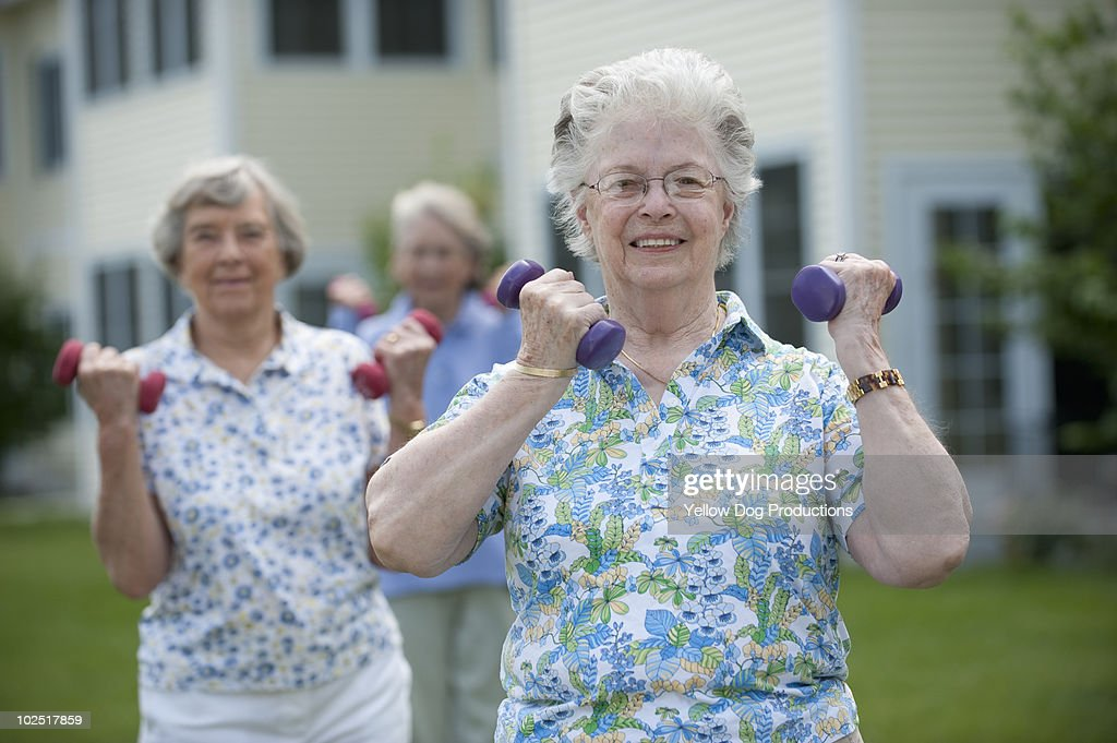 Senior women exercising outdoors