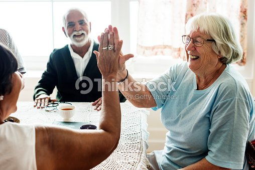 Senior women giving each other high five : Foto stock