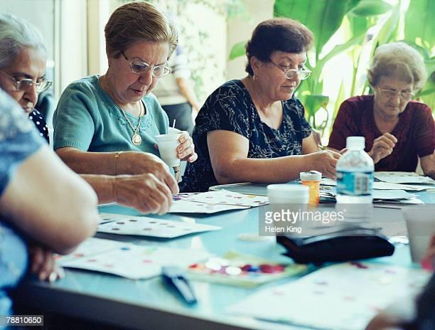 Senior Women Playing Bingo at Adult Daycare Center