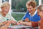 Senior women playing cards