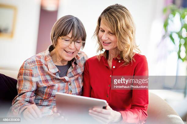 Senior Women Playing With Digital Tablet