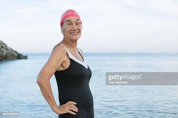 Senior women posing at beach one piece swim suit