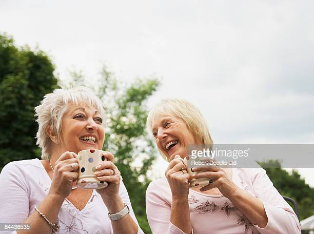 Senior women sharing a joke.