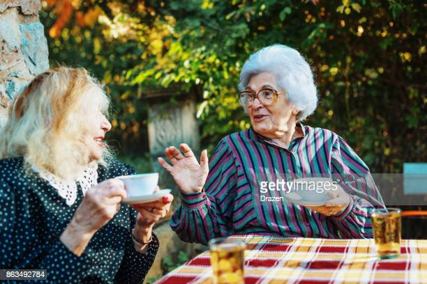 Senior women sharing secrets and behave like teens