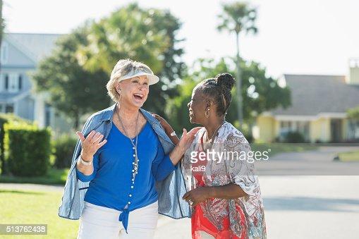 Senior women taking a walk on a sunny day, talking