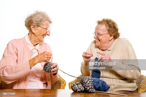 Senior Women Talking and Knitting Together
