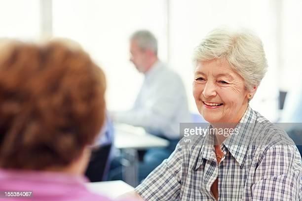 Senior women talking in community center