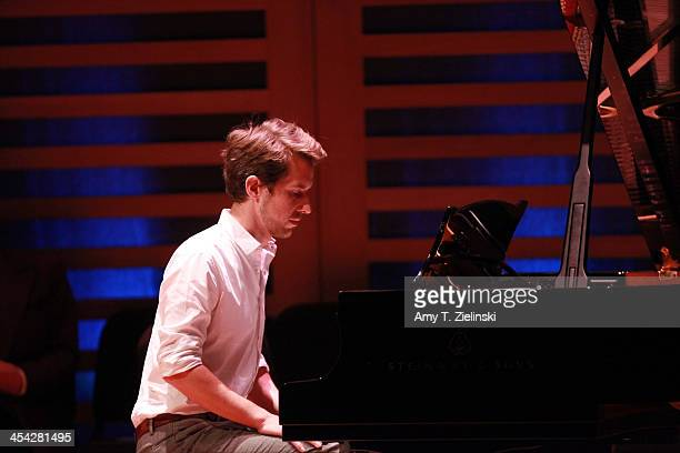 Senior writer Richard Godwin of the Evening Standard plays on the piano a movement from composer Robert Schumann's Kinderszenen on stage during...