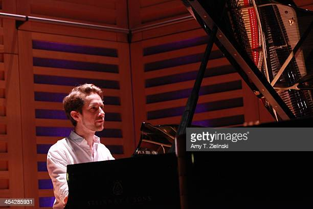 Senior writer Richard Godwin of the Evening Standard plays on the piano at rehearsal a movement from composer Robert Schumann's Kinderszenen on stage...