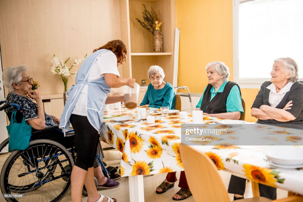 Seniors At The Retirement Home Having Breakfast : Bildbanksbilder