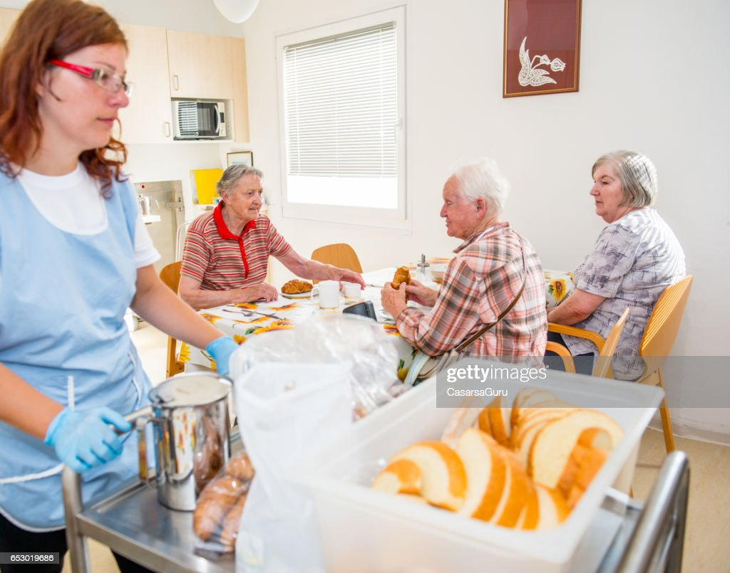 Seniors At The Retirement Home Having Breakfast : ストックフォト