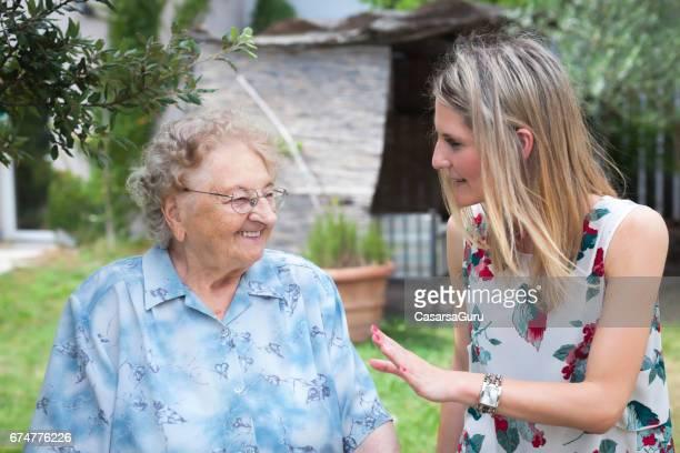 Seniors Enjoy The Back Yard Of The Retirement Community